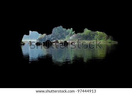 Cave opening as seen from within, on the river at Tam Coc scenic spot, Ninh Binh, Vietnam.