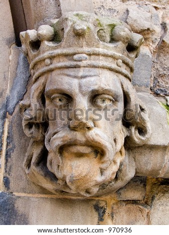 Caved head on ancient church in Birmingham, England - stock photo