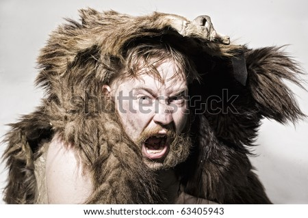 Caveman in bear skin