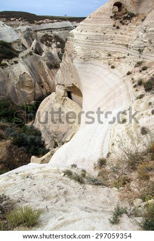 Caves carved from the colored tufa formations in Kizilcukur valley  of Cappadocia, Turkey