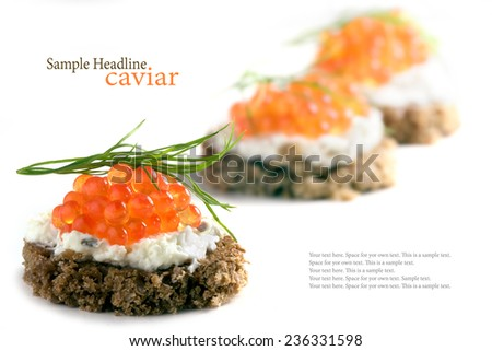 caviar canapes, red, with dill garnish, some party snacks blurred in the background, isolated on white, sample text in the copy space - stock photo