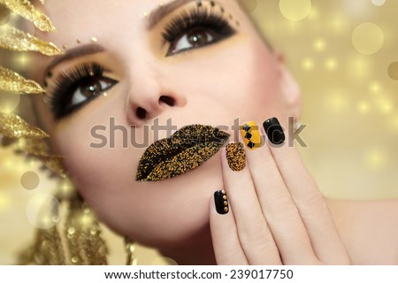 Caviar manicure in yellow black nails with black and gold sequins and beads colored lips. - stock photo