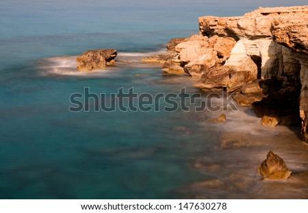 Cavo Greco or Cape Greco sea caves  in Cyprus, Mediterranean Europe  - stock photo