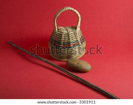 Caxixi, bazueta, and dobrao, traditional brazillian instruments on red background