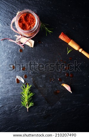 Cayenne Marinade Meat Powder and Brush on Dark Gray Table. - stock photo