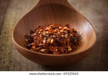cayenne pepper in a wooden spoon - stock photo