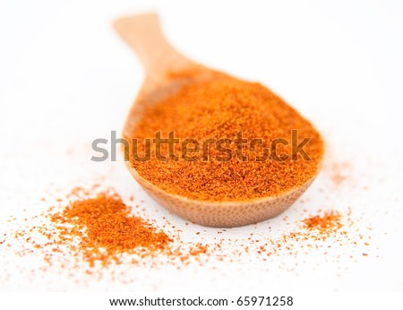 Cayenne Pepper or Turmeric Spice in Bamboo Wooden Spoon - stock photo