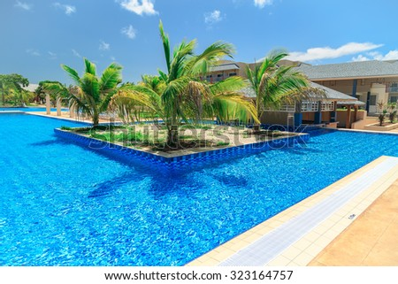 Cayo Coco island, Melia jardines del rey,Cuba, Sep 2, 2015 amazing inviting gorgeous view of swimming pool, tranquil turquoise azure water and tropical garden against pretty blue sky background