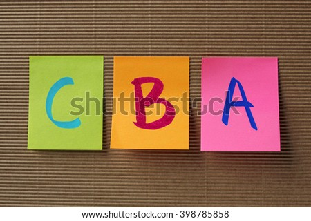 CBA (Cost benefit analysis) acronym on colorful sticky notes - stock photo