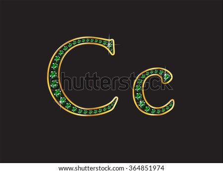 Cc in stunning emerald precious round jewels set into a 2-level gold gradient channel setting, isolated on black. High-resolution raster JPEG version.  - stock photo