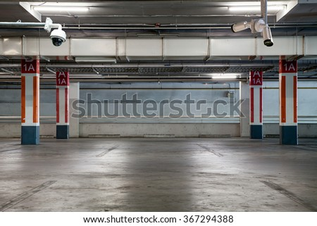 CCTV camera in Parking garage interior, industrial building,Empty underground parking background - stock photo