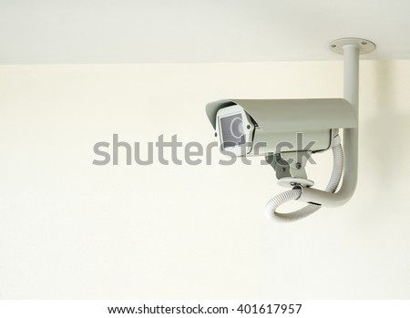 cctv camera installed on ceiling in indoor security system on white wall