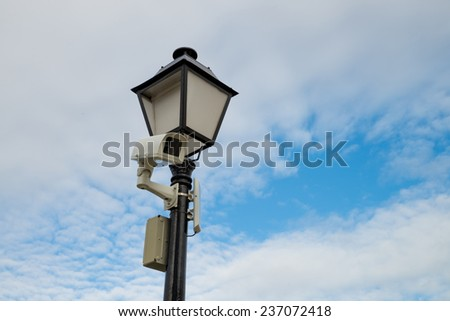 CCTV  camera mounted on a  classic street lamp