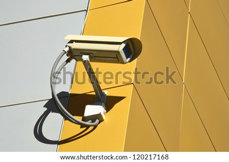 CCTV camera on the cone of the morden building - stock photo