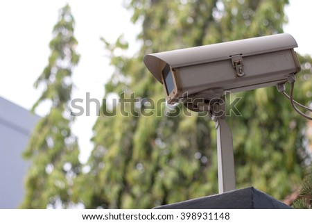 CCTV camera on top of building  - stock photo