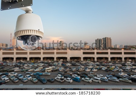 CCTV Camera Operating in outdoor car park - stock photo