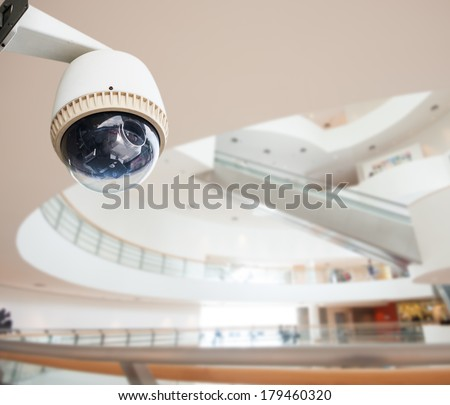 CCTV Camera Operating inside a building - stock photo