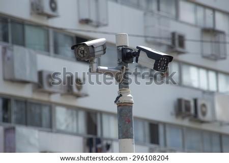 CCTV Camera or surveillance on apartment or condominiumin background - stock photo