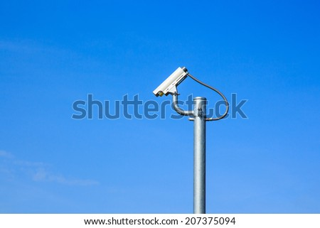 CCTV camera or Surveillance Operaiting on Blue Sky.