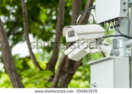 CCTV camera or surveillance operating - stock photo