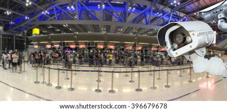 CCTV camera or surveillance operating in air port.  - stock photo