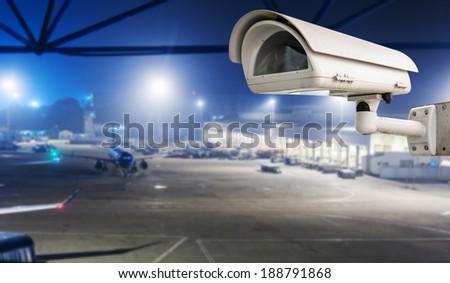 CCTV camera or surveillance operating in air port run way - stock photo