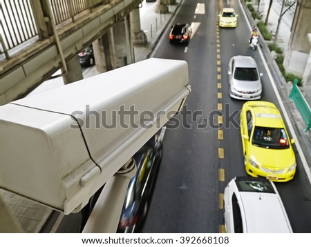 CCTV Camera or surveillance Operating on traffic road. CCTV Security Camera or surveillance operating on traffic road and urban scene. - stock photo