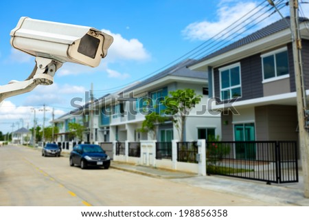 CCTV Camera or surveillance with village in background - stock photo