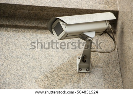 CCTV camera. Security camera on the wall. Private property protection