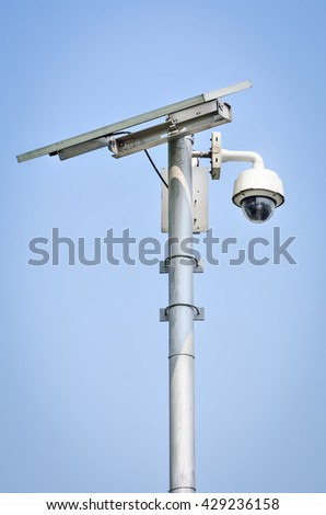 CCTV camera security with Solar panel in a big city - stock photo