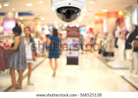 CCTV camera spy on the shopping mall. - stock photo