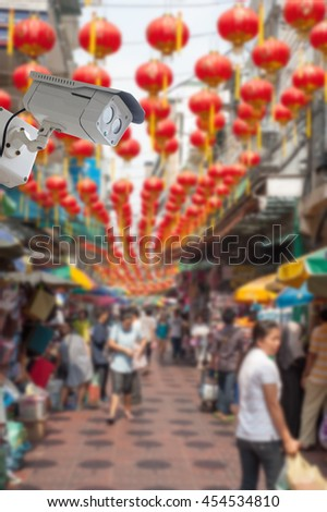 cctv camera with china town, Bangkok blur background - stock photo
