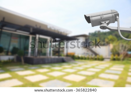 CCTV Camera with house background. - stock photo