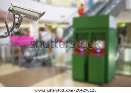 CCTV cameras observe the ATM to prevent theft. - stock photo