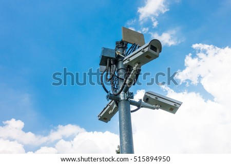 CCTV cameras, security cameras against blue sky with copy space