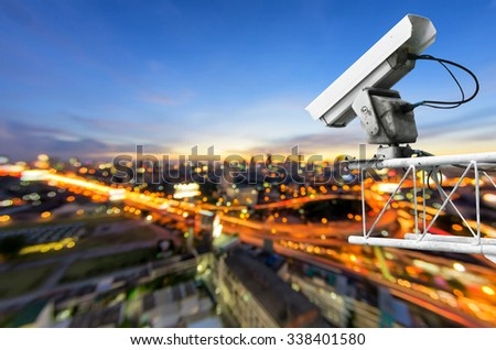 CCTV cameras, security cameras. With the backdrop tail lights blurred on the road from a high angle. - stock photo