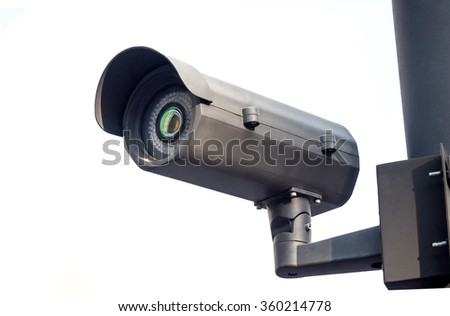 cctv installed on the pole in outdoor security system on white