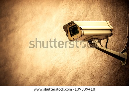 CCTV on a brown wall - stock photo
