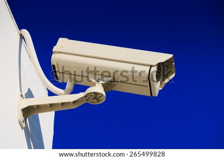 CCTV on building with blue-sky background