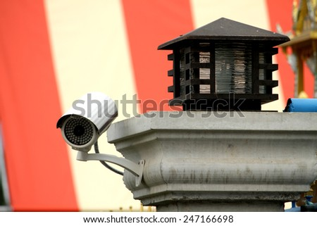 CCTV on lamp post - stock photo