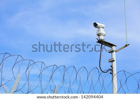 CCTV on top of chain link - stock photo