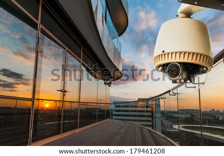 CCTV operating outside office balcony - stock photo