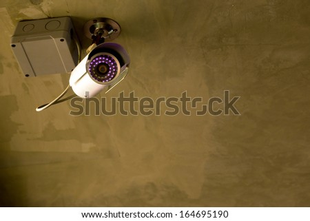 CCTV security camera at night  - stock photo