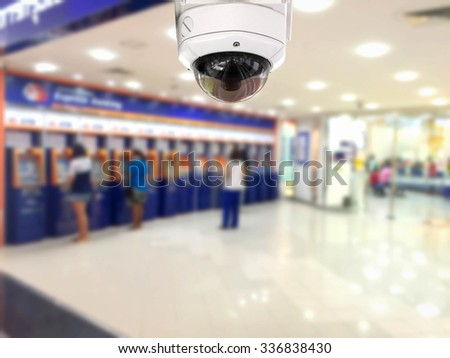 CCTV Security camera Auto teller machine(ATM)  area background. - stock photo