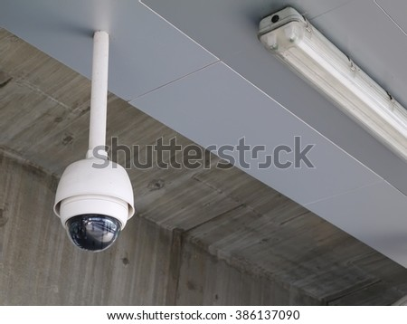 CCTV security camera for protection, privacy, security against crime & surveillance. Security CCTV camera installed in public area as office building, station or parking lot for protection security. - stock photo