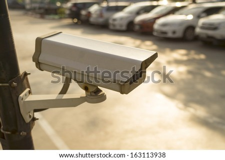 CCTV security camera outdoor at car park - stock photo