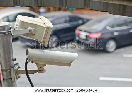 CCTV security camera outdoor at car park. - stock photo