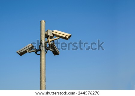 CCTV security with blue sky - stock photo