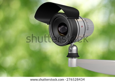cctv video camera security system in green background - stock photo