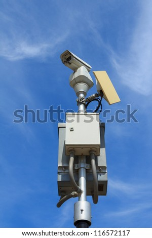 CCTV with microwave transmitter under blue sky